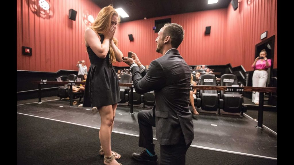 Propose in a theater