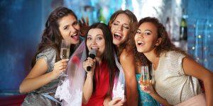 Beautiful girls with microphone in nightclub