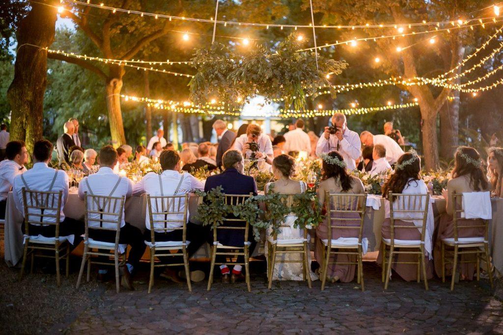 An outdoor wedding in an open restaurant