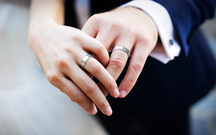 engagement ring on fourth finger of the left finger