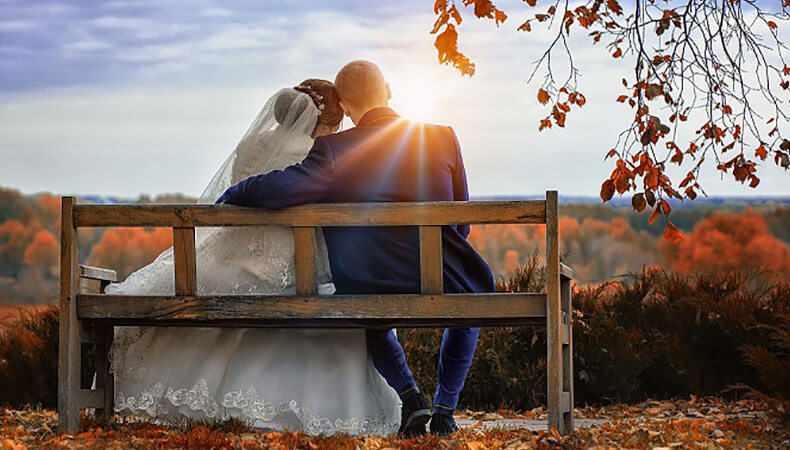 Couple seating on bench after successful marriage