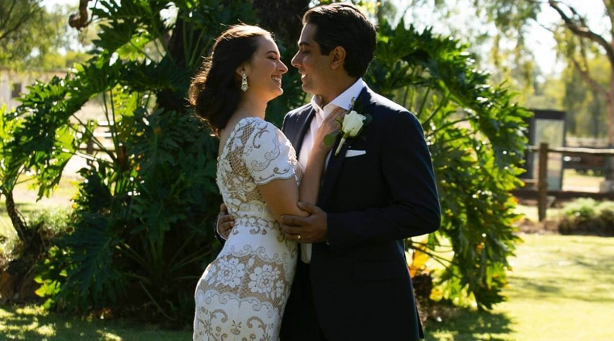 Evelyn wore an all-white wedding gown, while Tushaan wore a tuxedo