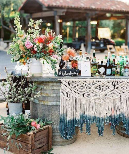 Beautiful backdrop with vibrant flowers and lots of macramé