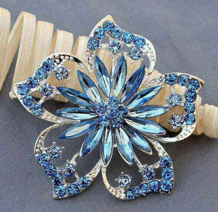 Crystal broach with blue embellishments