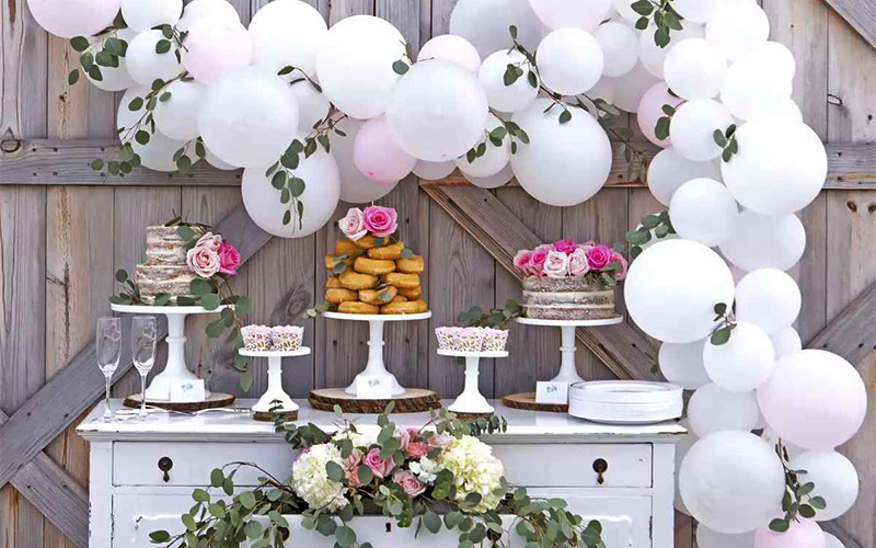 Decorate the wedding reception dessert table with balloons