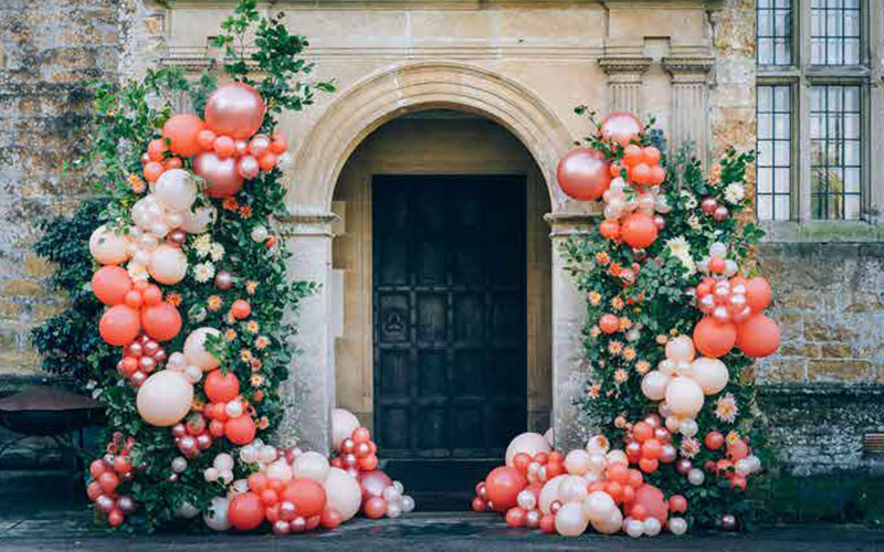 Stunning wedding entrance arch with balloons